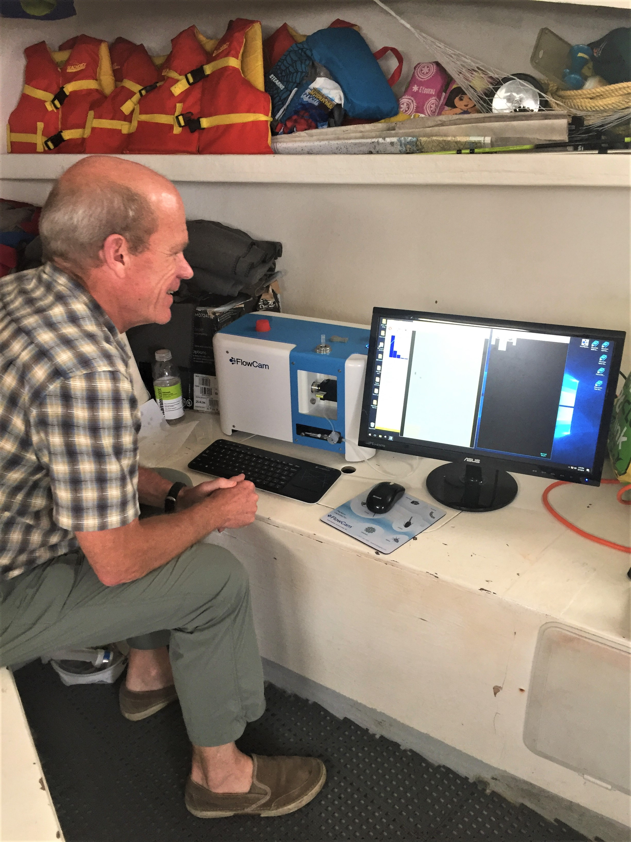 Harry Nelson using the FlowCam on board with the BLOOM Educators Program