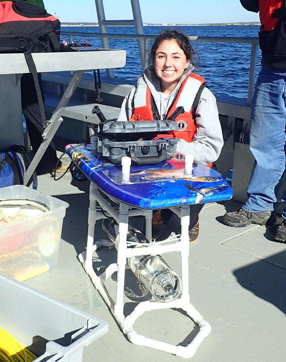 UNE student Ariella Danzinger with her zooplankton suction and collection device on boat